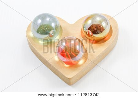 Colorful Glass Marble On Hart Shape Wooden Base