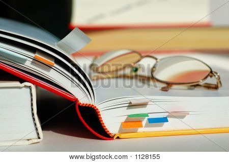 Opened Book And Glasses