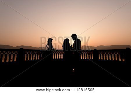 Silhouette of family visiting the palace Jal Mahal at sunrise.