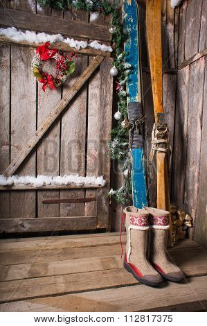 wooden skis standing near the porch