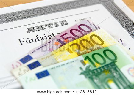Share with fanned out Euro banknotes and depth of focus