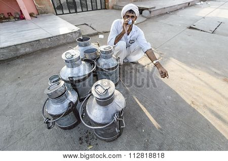 Daily traditional milk market at the street of Jaipur India.