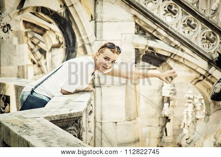 Young Tourist Woman On The Milan Cathedral, Italy