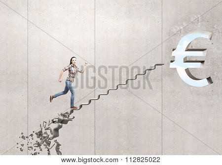 Young woman walking up collapsing staircase representing success concept