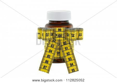 A brown medicine bottle with yellow measuring tape decorated as a ribbon, isolated on white background