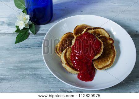 pancakes for brekfast near beautiful white flowers in bottle