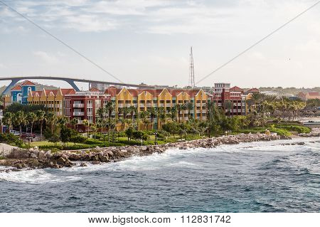 Colorful Resort And Bridge In Curacao
