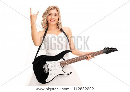 Young bride holding a guitar and making a rock hand gesture isolated on white background