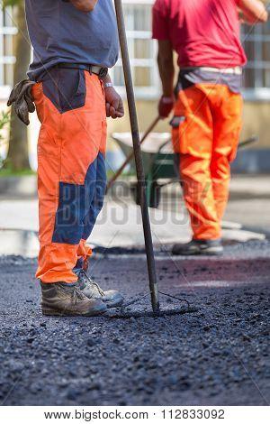 Asphalt surfacing manual labor.