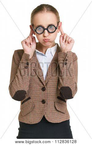 Girl in eyeglasses grimacing in isolation