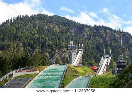 Two Ski-jumping hills in Oberstdorf with mountains in the background