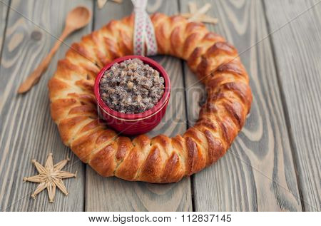 Kutia and Christmas bread, traditional Christmas dish in Ukraine and Poland over wooden background