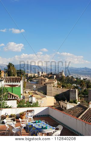 Rooftop terrace and the Palace of Alhambra.