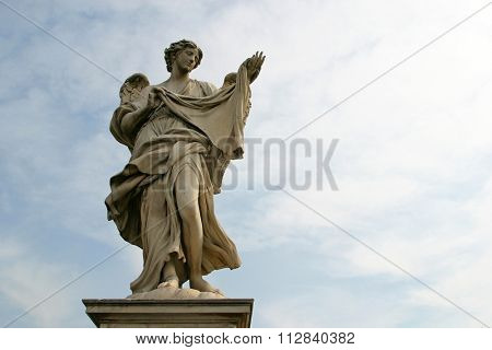 ROME, ITALY - FEBRUARY 27: Bernini's angel along the Holy Angel bridge near the Hadrian Mausoleum in Rome, Italy on February 27, 2010