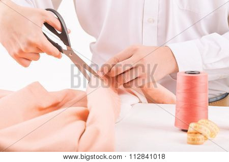 Person busy with cutting cloth.