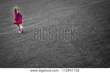 Girl running on the grass