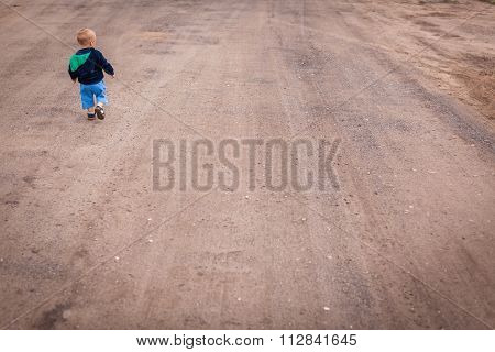 Little boy on a lonely walk