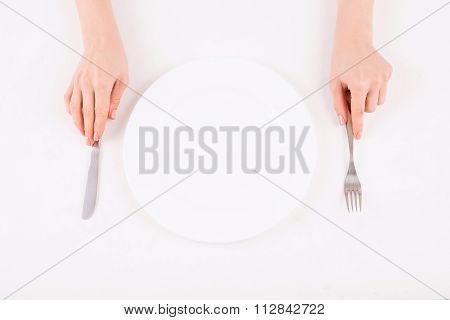 Female hands putting silverware on the table