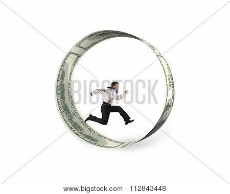 Businessman Running In Circle Of Dollar Bills