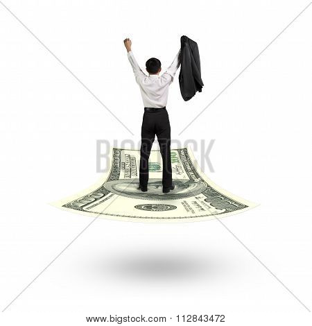 Businessman Cheering And Standing On Money Flying Carpet