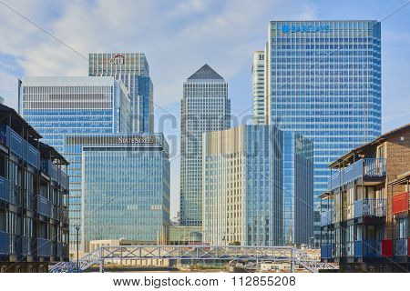 LONDON, UK - DECEMBER 28: Canary Wharf's banks' skyscrapers on sunny blue sky day seen from Blackwall. December 28, 2015 in London.