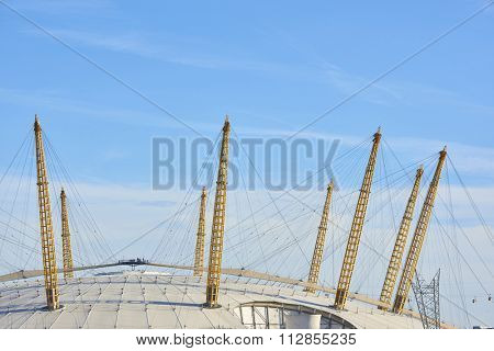 LONDON, UK - DECEMBER 28: Visitors at top of O2 Centre, formerly known as Millennium Dome, in a sunny blue sky day. December 28, 2015 in London.