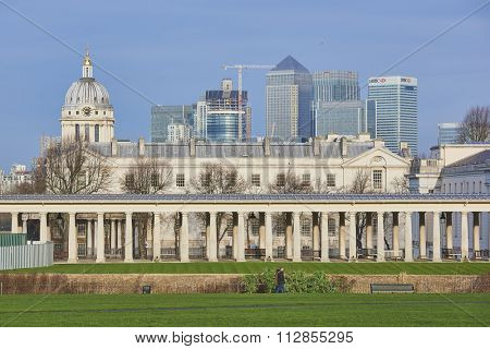 LONDON, UK - DECEMBER 28: Heavily built cityscape with National Maritime museum in the foreground and Canary Wharf skyscrapers in the background. December 28, 2015 in London.