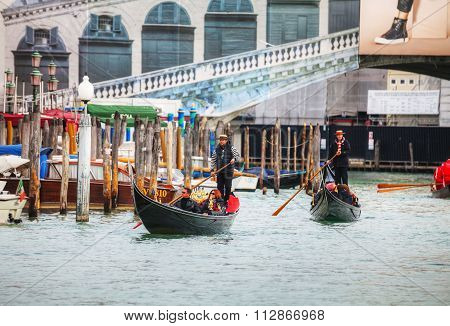 Gondolas With Tourists In Venice, Italy