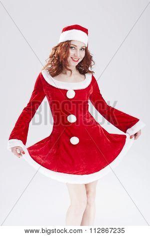 Happy Flirting Caucasian Female Santa Helper