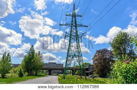 High voltage tower with cloudy sky on background