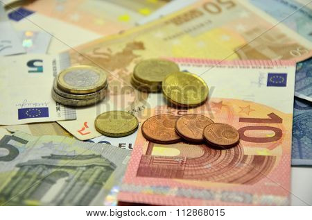 Photo bakground with euro banknotes and sorted stocked coins