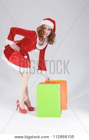 Christmas Concept and Ideas. Happy Looking Young Caucasian Red Haired Female Santa Helper