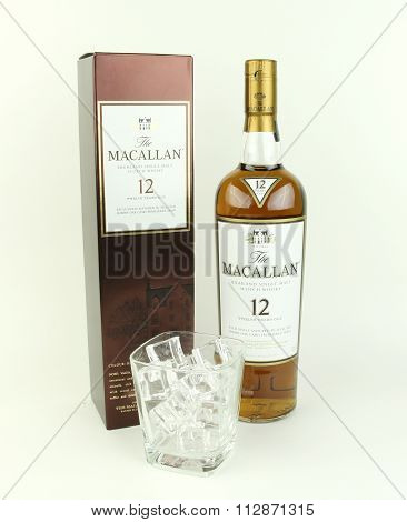 Bottle Of Macallan !2 Year Old Scotch Whisky With Ice Glass