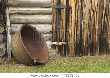 Rustic Log Cabin And Cooking Pot