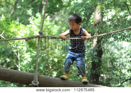 Japanese boy playing with tightrope (3 years old)