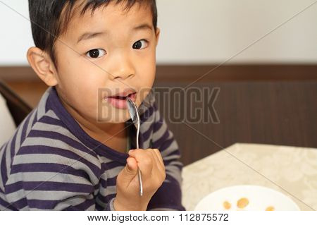 Japanese boy eating cereal (4 years old)
