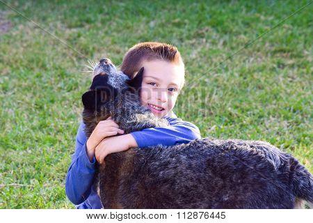 Happy boy hugging his dog