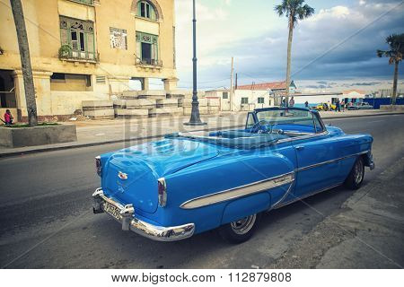 HAVANA, CUBA - 4 DEC, 2015. Blue vintage classic American car, commonly used as private taxi parked in Havana street.