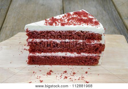Red velvet cake on a wooden background