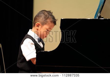 Japanese boy playing piano (4 years old)