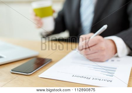business man checking finance report on table by using laptop,tablet and mobile phone