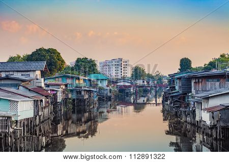 slum at waterside in sunrise morning
