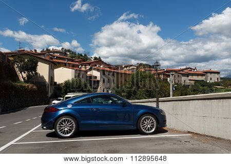 Audi TT in front of the village Verni in tuscany