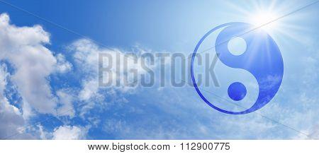 Symbolic Yin Yang on Blue Sky Banner