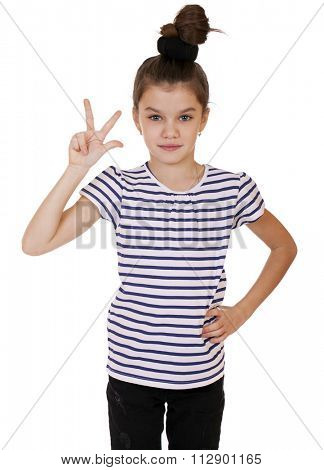 Gesture and happy people concept - smiling little girl in white blank t-shirt showing gesture with fingers