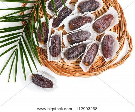 Group Of Date Fruits And Leaf Of Palm.