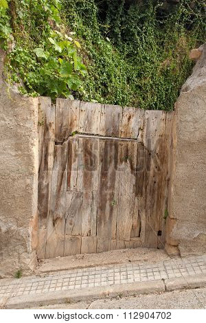 old crooked wooden door