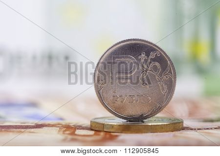 coin ruble on the background of banknotes