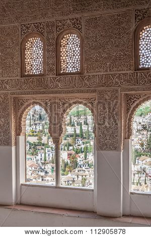 Nice arch windows in ancient Arabian palace Alhambra. Granada, Spain