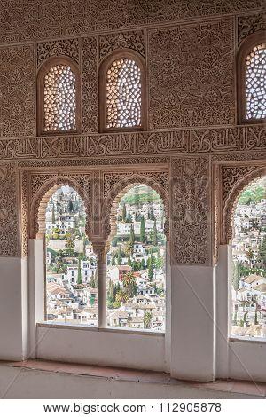 Nice arch windows in ancient Arabian palace Alhambra. Granada, Spain